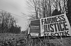 Fairness and Justice. Roadside sign related to a local labor dispute on a dark and gritty day in Nelson Township Ohio. Copyright 2015 by drei88 on flickr.