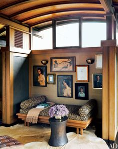 Black and tan is the palette of designer Ken Fulk's office in his San Francisco home, a color scheme picked up by the various nudes hung in a small alcove. The chic pairing of shades is also echoed in the leopard-print upholstery on the daybed designed by architect Warren Callister for the space.