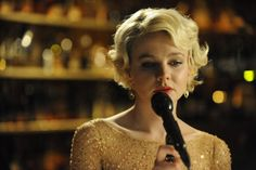 Carey Mulligan as Sissy Sullivan in Shame, a love addict who crashes on her brother's couch when she has nowhere else to turn.