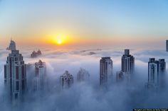 The sun shines above the fog in Dubai, United Arab Emirates