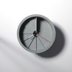 A wall clock made of concrete. The design makes it seem as if time is spiraling towards you. Designed by Sean Yu & Yiting Cheng