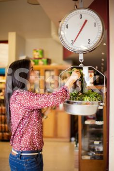 Weighing some vegetables royalty-free stock photo
