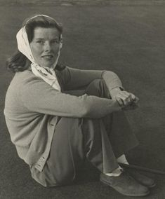 Katharine Hepburn seated on lawn, 1938.