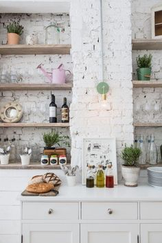 Rustic eclectic kitchen with a white brick wall - Decoist