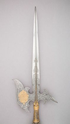 "art-of-swords:  "" Halberd of the Guard of the Electors of Saxony  • Dated: circa 1620  • Geography: Saxony  • Culture: Saxon  • Medium: steel, wood, gold, textile, metallic thread  • Dimensions: L. 8 ft. 8 ½ in. (265.4 cm); L. of head 50 ½ in. (128.3 cm);..."