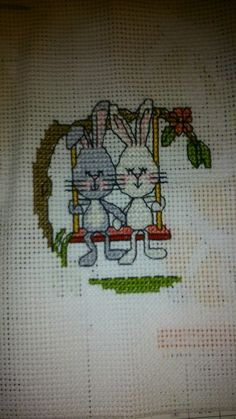 Bunnies holding hands in a swing