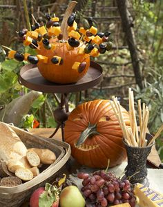 Creative Touches Keep food festive! Present cubed cheese and olives on skewers secured in a pumpkin.