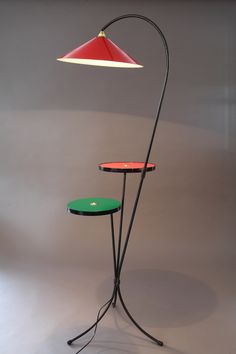 Mid-20th century black laquered metal floor lamp with red and green laquered wood gueridons. French work in the taste of Pierre Guariche.