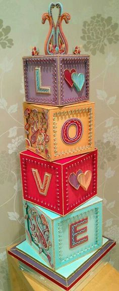 Awesome Cake Art, Blocks with Love. I think with a floral topper that this would make a cute wedding cake.