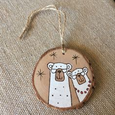 This cute and personalized polar bear wood ornament features a cute heart with initials on the back. Let me know what year you would like added in the note to seller section during check out. The year 2016 will be added, unless otherwise noted. Thanks!  All of my wood burnings originate from a free hand drawing in pencil. With a wood burner I outlined the drawing and filled it in with acrylic paint, followed by a couple of coats of varnish to protect the piece from wear and tear. This rustic…