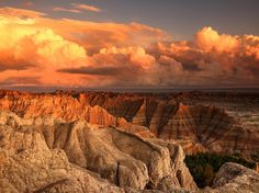 The sun sets over South Dakota's Badlands following an afternoon rain shower [Photo by Ken Stewart, National Geographic Your Shot].