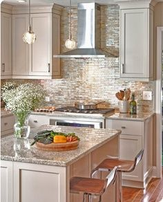 kitchen - illustrates that the tile goes behind the hood...