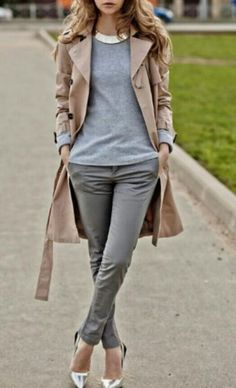 Shop this look for $94: http://lookastic.com/women/looks/crew-neck-sweater-and-trenchcoat-and-skinny-pants-and-pumps-and-necklace/3818 — Grey Crew-neck Sweater — Tan Trenchcoat — Grey Skinny Pants — Silver Leather Pumps — Gold Necklace