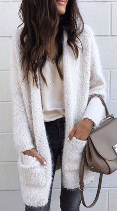 Long fuzzy white cardigan with slouchy white blouse and dark denim jeans. Business casual outfit #outfits