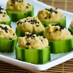 These Hummus and Cucumber Appetizer Bites with Sesame Seeds are an easy and nutritious Superbowl snack.- going to substitute pitted Kalamative olives for the sesame seeds Cucumber Appetizers, Cucumber Bites, Healthy Appetizers, Appetizer Recipes, Healthy Snacks, Healthy Recipes, Diet Snacks, Cucumber Cups, Healthy Options