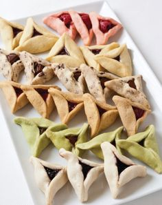 Hamantaschen are filled, triangle shaped cookies, that are traditionally eaten on the Jewish Holiday of Purim.