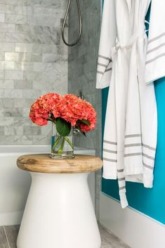 The brightest room in the home color-wise, the attractive terrace suite bathroom offers a simple space to take a shower or bath with aqua walls that provide a punch of personality. >> http://www.hgtv.com/design/hgtv-dream-home/2017/terrace-suite-bathroom-pictures-from-hgtv-dream-home-2017-pictures?soc=pinterest
