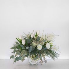 If you are the imaginative type, a simple floral craft book will provide you all the ideas and tool lists required to produce your own customized wedding flowers that reflect your personal design. Winter Flower Arrangements, Christmas Arrangements, Christmas Decorations, Christmas Flowers, Winter Flowers, White Christmas, Xmas, Winter Centerpieces, Wedding Centerpieces