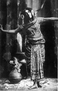 Portrait of Mata Hari (1876-1917), Dutch dancer and spy for Germany during World War I, standing, with snake around her middle.  Date taken:	1915