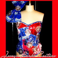 This corset is made of patches of NY Giants logo cotton, White Alencon lace, Red sequinned jersey  and satin, Royal Blue embroidered sequinned floral tulle, and hand beaded with multi-colored Swarovski crystals and White crystallized sequinned flowers. The one shoulder strap has crystal trim, and an oversized bow. White satin lacing down the back. Please specify your size in your order. NOTE: THIS CORSET IS AVAILABLE IN ANY TEAM, AND COMES WITH A MATCHING HAT SOLD SEPARATELY. Pleas...