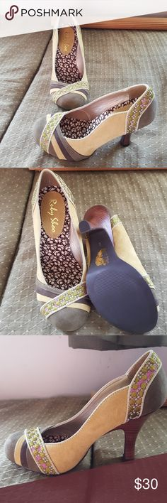 Adorable heels Shades of olive green with just a splash of pink. These say size 36 but they run about a half size small, so lusting them as 5.5's. Already reordered these in a bigger size and I wouldn't be selling if they fit! These look like suede, but I don't have the box anymore to know if they are or not. Never worn. ruby shoo Shoes Heels