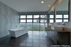 TREND ALERT: Bathrooms with a view An abundance of glass and killer views are making it big in the bathroom. Check out our top picks of bat...