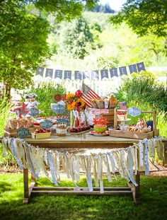 A DIY Vintage Fourth of July Celebration.Love all these ideas + Summer + Vintage + Party + Alfresco + Table Setting + Outdoor Party Ideas 4th Of July Celebration, 4th Of July Party, Fourth Of July, Fabric Strip Garland, Ribbon Garland, Ribbon Banner, Fabric Bunting, 4. Juli Party, Diy Vintage