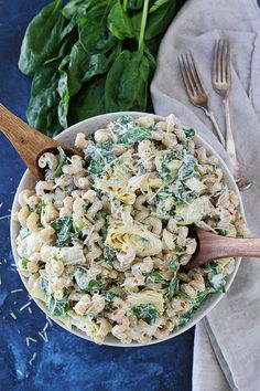 If you like Spinach Artichoke Dip, you will LOVE this easy Spinach Artichoke Pasta Salad! It is a great side dish for parties and potlucks.