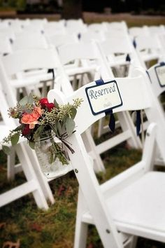 Romantic, Floral Wedding Aisle Designs - I like the way they did the reserved seating signs for front row