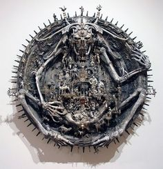 Kris Kuksi is a 36-year-old sculptor from Missouri, USA. His sculptures are created out of discarded toys, old mechanical parts and other tossed away items.
