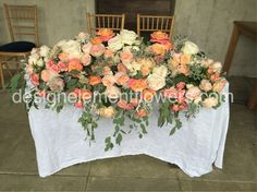 Peach and Ivory Top Table Arrangement