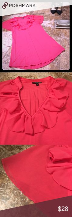 """Express Ruffle sleeve Top Gorgeous coral top perfect for the spring wardrobe transition fun ruffles around the neckline with a sheer flutter sleeve. Looks great tucked into a pencil skirt under a blazer or half tucked in a pair of skinnies with slip on sneaks and a cute bomber. Top was only worn a handful of times. In EUC. NO FLAWS!!! Smoke free home. Top measures 26.5"""" from top to bottom hem. Busy measures 16"""" across. Soft and silky material. Has nice stretch to it. Questions? Just ask…"""