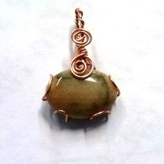 tumbled piece of petrified wood in a simple copper wrap