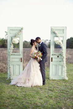 upcycled doors as a ceremony backdrop, photo by Christa Elyce http://ruffledblog.com/eco-friendly-garden-wedding-ideas #weddingideas #ceremony #backdrops