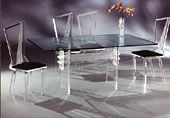"""Double H Crystallized Table, 42"""" x 72"""" Glass Top w/Acrylic legs. Venus Dining Chairs with black suede seat cushions.  From munizplastics.com, 4/3/16"""