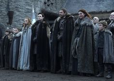 The Stark family awaits the arrival of King Robert Baratheon in very weather-appropriate cloaks. From left to right: Brandon, Arya, Sansa, Robb, Ned, Catelyn and Rickon. Special shoutouts go to Sansa for choosing a warmer, ice blue color and Catelyn Tully for the luxe fur lining and intricate embroidery.