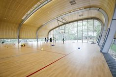 Image 4 of 32 from gallery of Milson Island Indoor Sports Stadium / Allen Jack+Cottier Architects. Courtesy of AJ+C Stadium Architecture, School Architecture, Interior Architecture, Australian Architecture, Fachada Colonial, Sports Stadium, Youth Center, Sports Complex, School Design