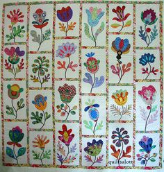 applique quilt, love this blogspot. has some pretty appliqued quilts