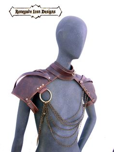Part necklace, choker, part epaulettes, part armor....These leather epaulettes are built with a brown leather and accented with antique