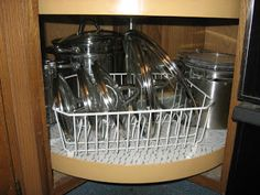 Use a dish drying rack to organize pot lids