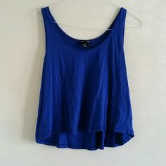H&M royal blue basic crop Royal blue crop top. High-low cut with wide arm holes. Perfect breezy feel! 25% off all bundles! H&M Tops Crop Tops