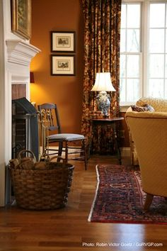 Living room with burnt orange wall -- Classic Hill Interiors -- photo: RVGP Photo+Graphics