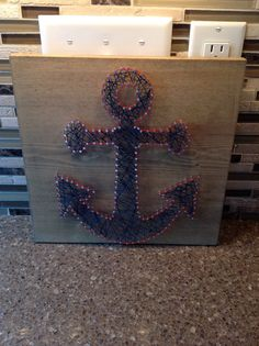 Hand made Anchor Nail String Art. Made to order (choose) -dark or light stain -string color (s)