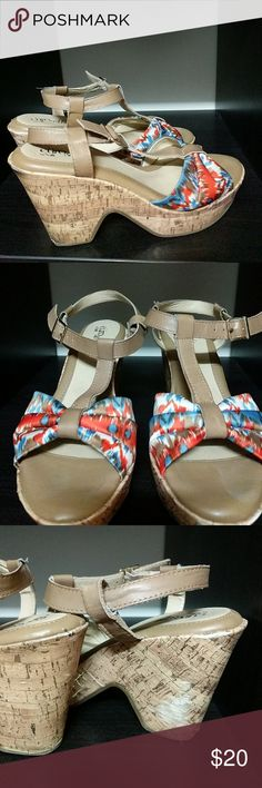 Comfortable wedge sandals Super cushiony wedge sandals. Beautiful colors. Cork bottoms. Scuff shown in photograph on inside of shoe. Sofft Shoes Sandals
