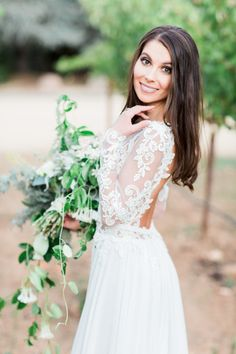Gorgeous lace long sleeve wedding dress: http://www.stylemepretty.com/little-black-book-blog/2016/02/03/rustic-elegant-fall-wedding-at-chateau-st-jean/ | Photography: Koman Photography - http://komanphotography.com/