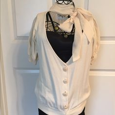 Dressy cardigan with chiffon bow around the neck. Cream business cardigan. Cute rap around chiffon bow at the neck. Chiffon back. Square shell double stacked buttons down the front. Cute with pencil skirt and heels. Worn only once. Twelve by twelve Los Angeles Tops Blouses