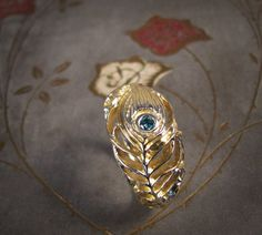 Peacock ring with blue diamond!
