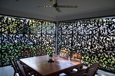 Sliding laser cut screens black in Vines Design