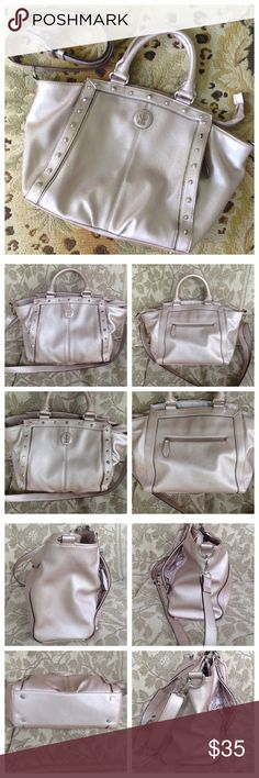 """Beautiful JL Spacious Silver Plum Bag Purse JL. Beautiful spacious handbag. Silver plum color. Measures around 12 1/4"""" long x 11.5"""" tall x 4"""" across. 5"""" double handles with 53"""" adjustable shoulder strap. Has 3 large inside compartments. Middle one zips together and has inner zip compartment as well as 2 slip in slots. Outer inside snap closures. Outside back has a zip compartment. Outside front has 2 side zip compartments. Looks new! Bags Satchels"""