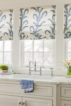 Window treatments in a kitchen add pattern and shade.